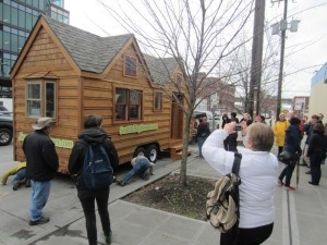 People visiting Ballard model tiny home.